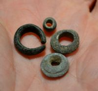 A good group of 4 x Late Bronze Age bronze beads / hair rings from Essex. SOLD